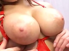 Азиаточка с очень большими сисками в красной коже