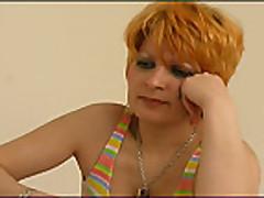 Зрелая россиянка с рыжими волосами